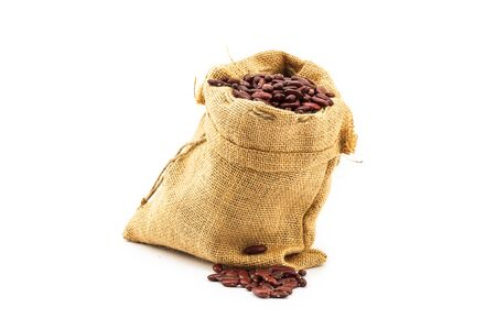 Uncooked red kidney bean on white background