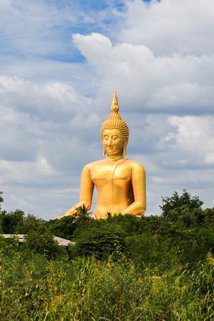 seated: Biggest Seated Buddha in Thailand at Wat Muang, Ang Thong Stock Photo