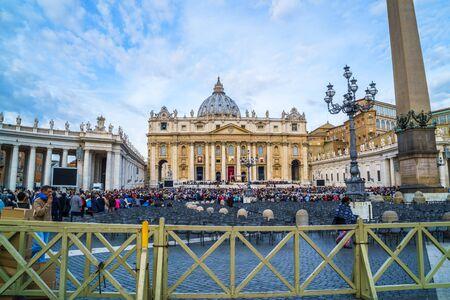 basillica: Basilica of Saint Peter, Vatican City - October 18, 2015 : Crowd of people praying at Basilica of Saint Peter in Vatican City on October 18, 2015.