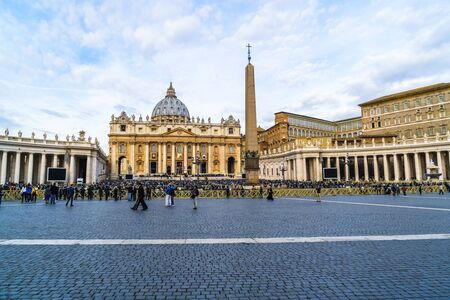 basillica: Saint Peters Basilica, Vatican City - October 18, 2015 : Crowd of People and Belivers praying at Saint Peters Basilica in Vatican City on sunday October 18, 2015.