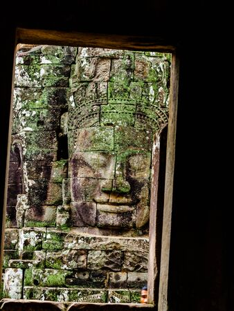 siem reap: Ancient stone carving of smiling face at Bayon Temple in Siem Reap, Cambodia