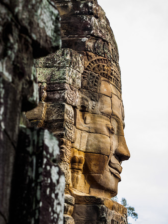 siem reap: Ancient stone carving face at Bayon Temple in Siem Reap, Cambodia