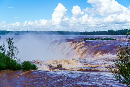 turbid: Iguazu Falls with the droplets of water floating in the air Stock Photo