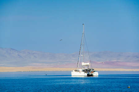 south pacific ocean: White ship in the South Pacific Ocean at Paracas Peru Stock Photo