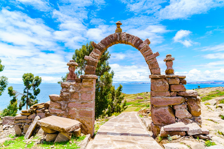 keystone: The stone arch leading to the main square of Taquile Island in Lake Titicaca Puno Peru