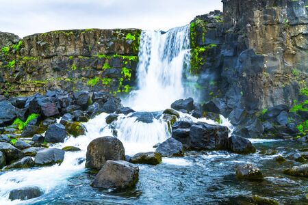 Oxararfoss waterfall at Thingvellir National park in Iceland