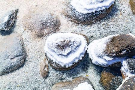 salt flat: Detail of salt precipitated on rocks in Uyuni Salt Flat Bolivia Stock Photo