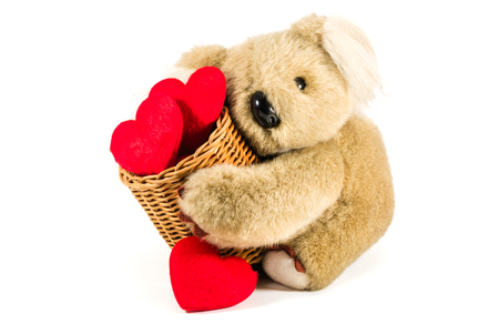 bear s: Cute teddy bear carrying bamboo basket full of red hearts for valentine s day