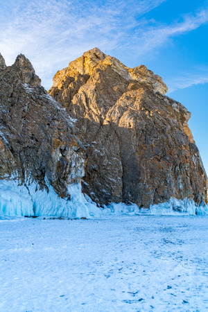 Famous Deva Rock with snow and icicles at northern Cape Khoboy in Frozen Lake Baikal, Russia Stock Photo