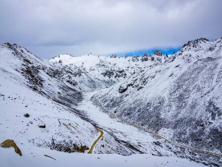 Aerial view of highway at the valley of snow mountain in Sichuan China Stock Photo