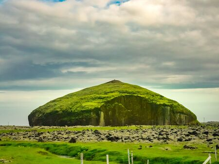 Big rock in the field of volcanic rocks covered with moss at Vatnajokull National Park in Iceland Stock Photo