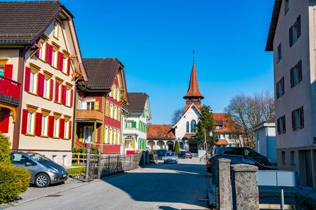 AppENZELL, SWITZERLAND -MARCH 24, 2018  : View of colorful house and the church at Appenzell Village in Switzerland Redactioneel