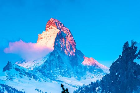 View of beautiful Matterhorn Peak with the golden glow of sunlight in the morning at Zermatt Village Switzerland