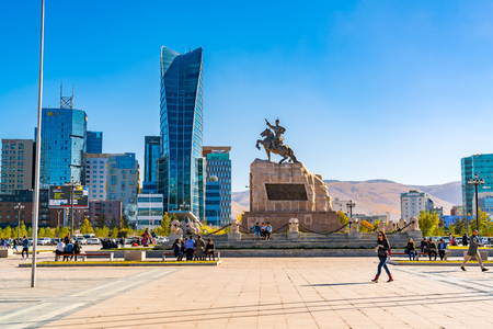 ULAANBAATAR, MONGOLIA - OCTOBER 3, 2018 : Sukhbaatar Square or Genghis Khan Square with the Statue of Mongolian revolutionary hero Sukhbaatar and the cityscape of Ulaanbaatar in Mongolia Editorial
