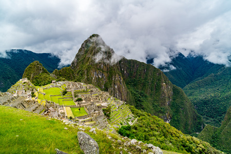 View of the lost Incan city of Machu Picchu in rainy day