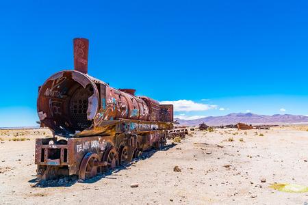 Rusty train in the famous train cemetry at Salar de Uyuni in Bolivia