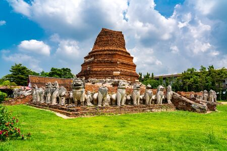 Ruin bell-shaped chedi surrounded by lions at Wat Thammikarat buddhist temple in Phra Nakhon Si Ayutthaya Province Thailand