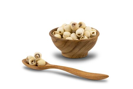 Dried Lotus Seeds in wooden bowl and wooden spoon on white background   . Nowadays lotus seed become popular healthy food and  highly beneficial for health. 版權商用圖片