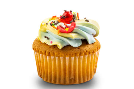 Vanilla cup cake garnished with butter cream frosting and colorful sprinkles isolated on white background Stockfoto