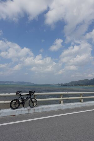 mini bike: a black carbon mini bike on a bridge in Ishigaki island, japan