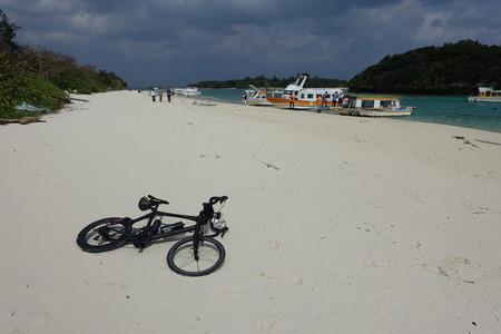 a black carbon bike laid on Kabira beach in Ishigaki island, Okinawa, Japan