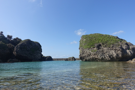 blue sky and water surface of a small cove in north part of Ogami island Stock Photo