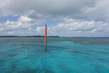 sign post: A sign post in the sea from Miyako island to Ogami island, Okinawa, Japan Stock Photo