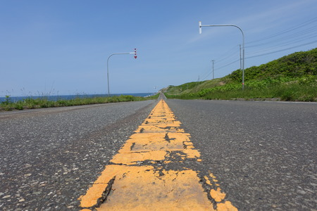 low angle views: the Center orange line of Ororon line road along Sea of Japan, in in Hokkaido, Japan