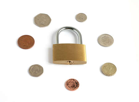 British coins with locked closed padlock isolated on white background
