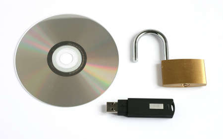 unlocked open padlock with usb memory stick and CD disk isolated on white background Stock Photo