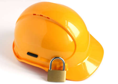 yellow hard hat with padlock isolated on white background Stock Photo