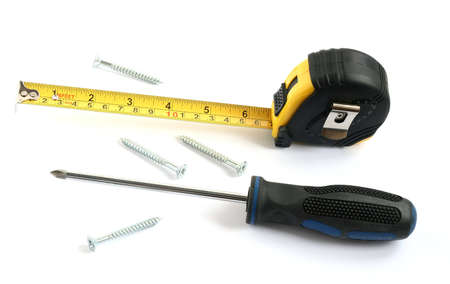 tape measure with screwdriver and screws isolated on white background