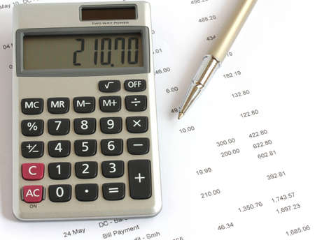 calculator and pen on financial data statement Stock Photo