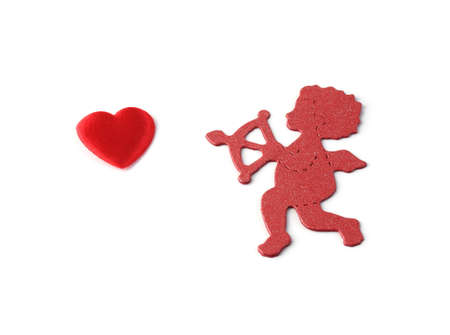 cupid pointing arrow at small red heart isolated on white background Stock Photo