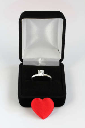 diamond engagement ring in a black velvet case with red valentines heart Stock Photo