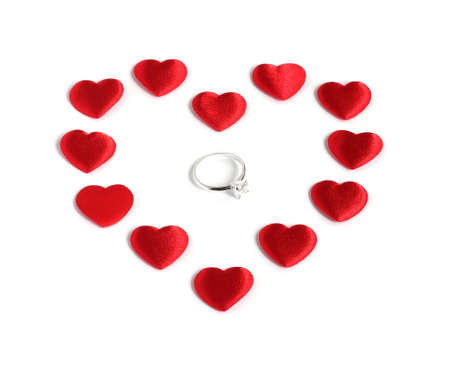 diamond ring inside red heart shape made of twelve small red hearts isolated on white background