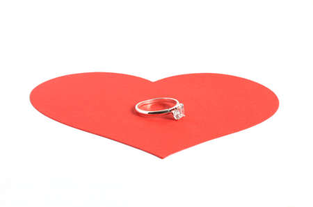 diamond ring on large red heart isolated on white background Stock Photo - 8889194