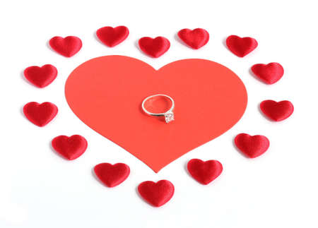 diamond ring on a large red heart surrounded by many smaller red hearts isolated on white background