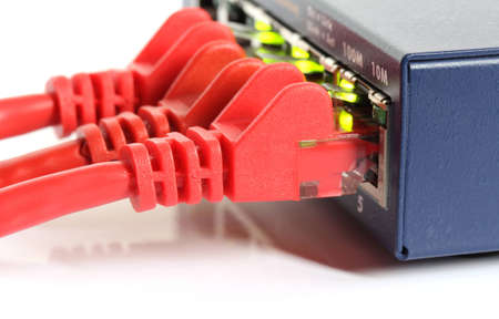 network router switch with red cables and green lights isolated on white background
