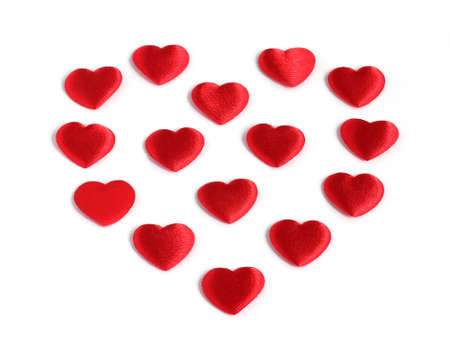 heart shape made from many small red hearts isolated on white background