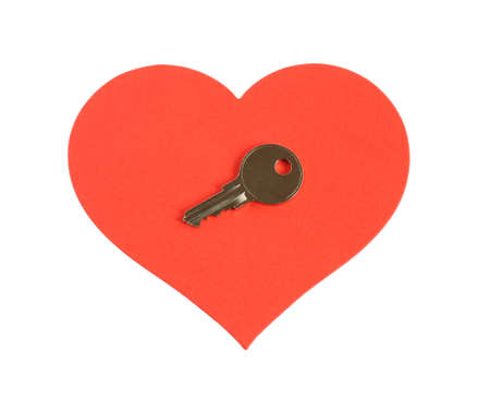 silver key on a large red heart isolated on white background