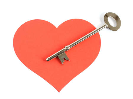 large silver key pointing to the center of a large red heart isolated on white background