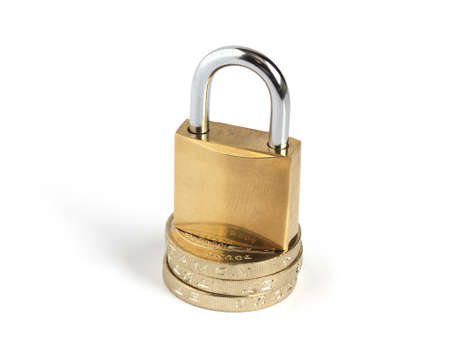 locked closed padlock standing on a pile of coins isolated on white background Stock Photo - 8889200
