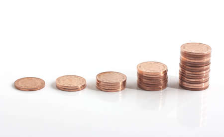 piles of copper coins increasing and doubling in height isolated on white background