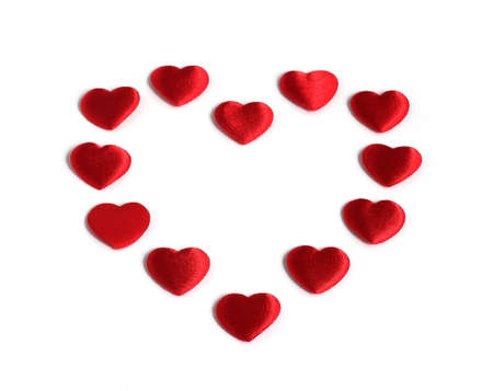 red heart shape made of smaller red hearts isolated on white background Stock Photo