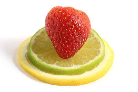 strawberry on lemon and lime fruit slices isolated on white background