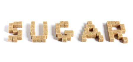 word sugar made up of brown sugar cubes