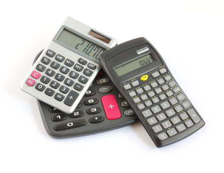 three different calculators piled up isolated on white background