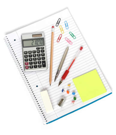 calculator pens pencil sharpener eraser sticky notes paper clips and drawing pins on notebook isolated on white background