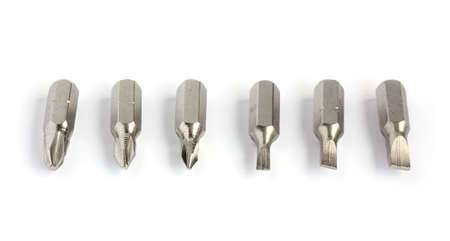 macro of six screwdriver bits in a line isolated on white background